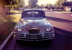 48 Packard. Tons of chrome. The best sounding straight 8 ever.